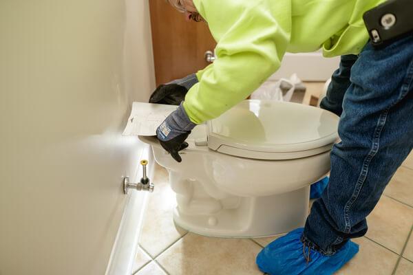 Expert completing HVAC maintenance
